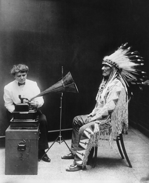 American ethnographer Frances Densmore (1867 - 1957) makes a phonographic recording of Blackfoot leader Mountain Chief at the Smithsonian Institution in Washington, DC, for the Bureau of American Ethnology, 16th February 1916. (Photo by FPG/Getty Images)